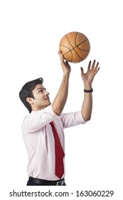 Businessman throwing a basketball