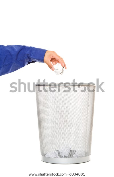 A businessman throwing out trash paper into a trash can