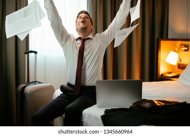 Businessman throwing papers in the air. Manager throws files.