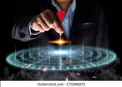 Businessman throwing red arrow dart to virtual target dart board. Setup objectives and target for business investment concept. - Shutterstock ID 1722840472