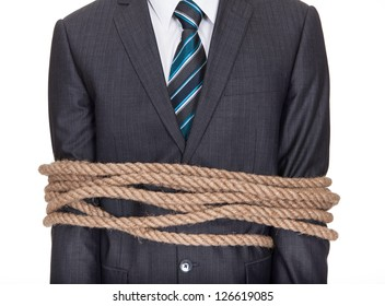 Businessman tied up in rope. Isolated on white