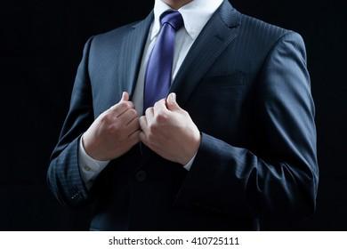 Businessman, tighten the tie