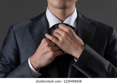Businessman tightening a tie