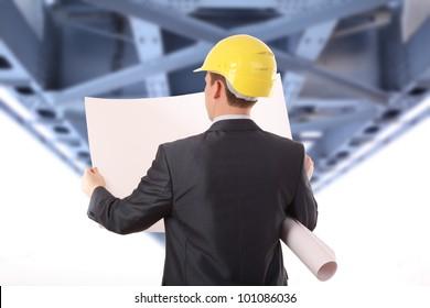 Businessman with time schedule under the bridge