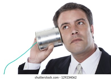 businessman with tin can phone over white