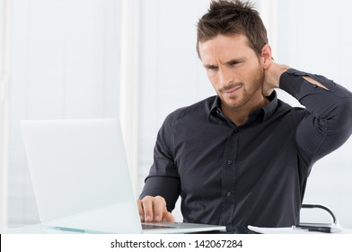 Businessman Tired Working On Laptop