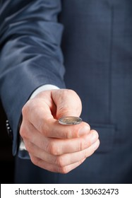 Businessman tossing a coin - closeup shot