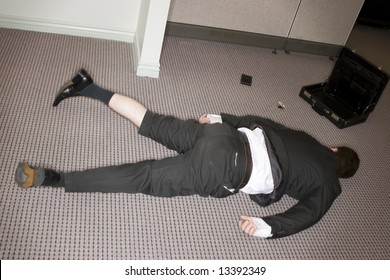 businessman totally collapsed on floor with briefcase open