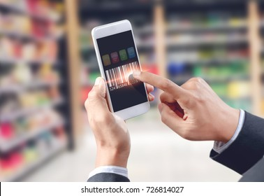 Businessman touch barcode on mobile device, warehouse and logistics