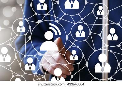 Businessman touch button communication group network