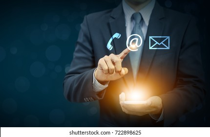 businessman touch email icon on hand, communication concept