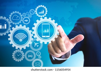 Businessman touch to force virtual gears for a concept of business driving and market mechanism