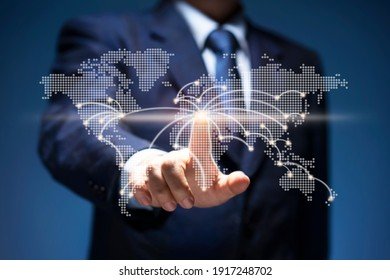 Businessman touch point of city connection line in world map. Man press button on virtual screen of planet earth show start up, business plan, communicate, technology, global network, internet concept