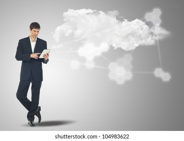 Businessman with touch screen Internet Tablet and the cloud computing concept and business network
