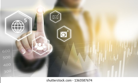 Businessman touch screen social icons. World connected, social media concept