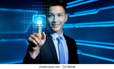 businessman touch smart home icon on blue background