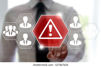 Businessman touched attention icon on touch screen on background of network business man. Attention mark with triangle sign. Web internet communication teamwork risk concept.