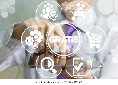 Businessman touched on a display a tablet pc and offers a gratis word surrounded by specific icons. Gratis (is free) shopping online business concept.