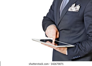 businessman touches the tablet with finger isolated on a white background