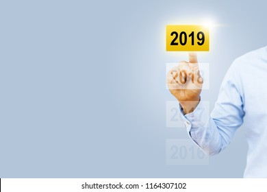 Businessman is touching 2019 card. Business growth concept new year 2019 or Concept for success in the future goal and passing time