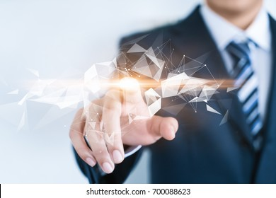 A businessman is touching an abstract space. Compute science, technology, business, internet concept.