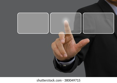 Businessman touching blank  buttons on virtual screen.