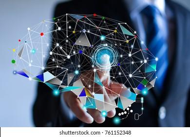 Businessman touching brain idea .