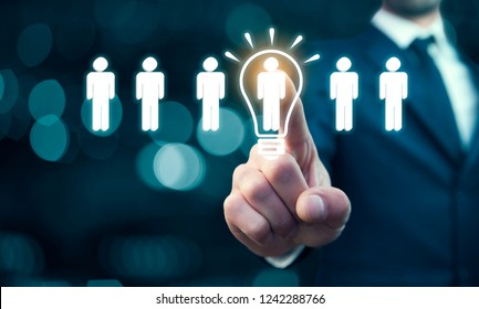 Businessman touching bulb idea with people team in screen