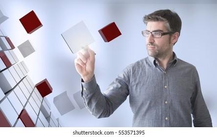 businessman touching cubes