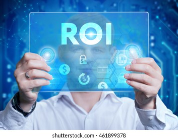 Businessman touching a dashboard with key performance indicator displayed with hologram on a virtual screen. ROI.