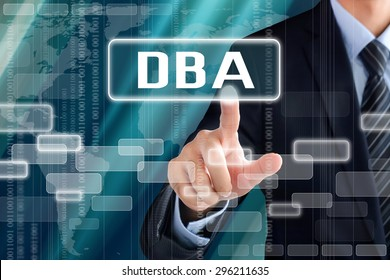 Businessman touching DBA (or Doctor of Business Administration) sign on virtual screen - education concept