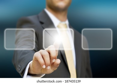 Businessman touching digital interface with his fingers