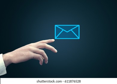 Businessman touching email icon on a virtual screen