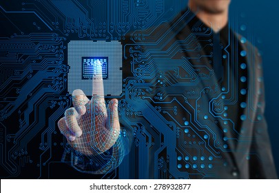 businessman touching glow CPU and electronics circuit