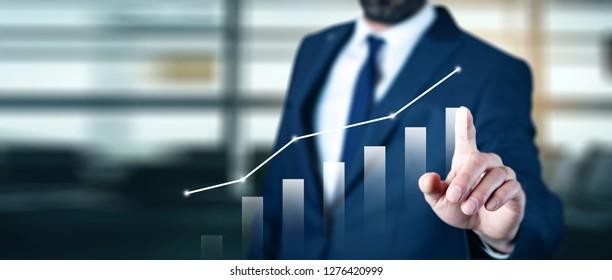 businessman touching graph in screen