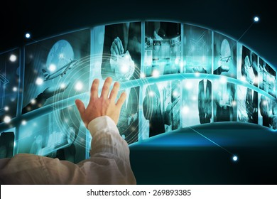 Businessman touching high tech interface