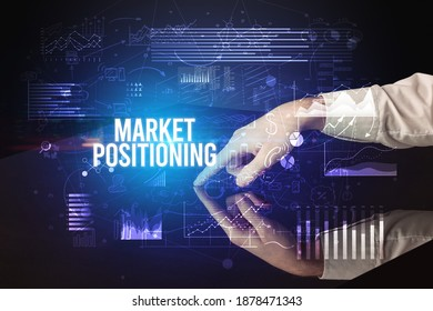 Businessman touching huge screen with MARKET POSITIONING inscription, cyber business concept