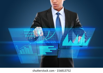 Businessman touching an icon on a touch screen monitor. conceptual image