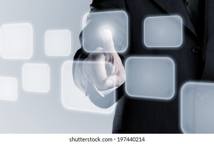Businessman touching infogram graphics on virtual touchscreen with copy space