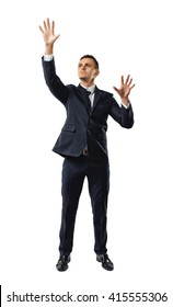 Businessman touching invisible wall. Front view. Obstacles and barriers. Office clothes. Dress code. Confusion and doubt. Search exit. Pantomime.