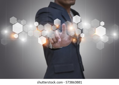 Businessman touching modern technology interface with gear wheel setting