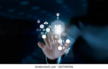 Businessman touching modern virtual interface HR network connection, data mining and social media. CRM and Human resources concept