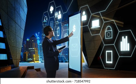 "Businessman touching ""Money"" sign on screen of digital booth with fintech infographic icon . Hi-tech business concept ."