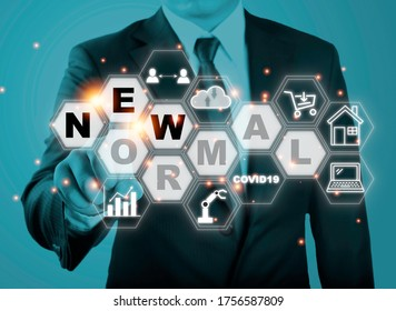 Businessman touching new normal wording with icon such as online shopping social distancing work from home and COVID19.The world is changing to balance it into new normal include business , economy ,  - Shutterstock ID 1756587809