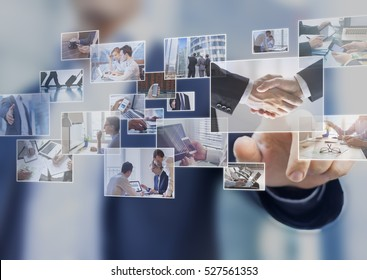 Businessman touching a photo on a digital screen interface, abstract images of business situations