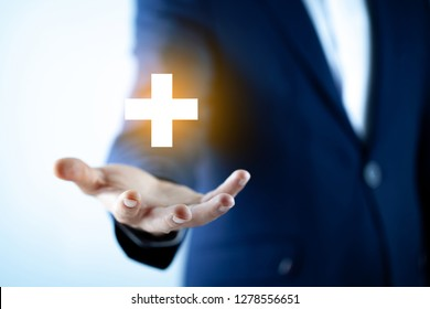 Businessman touching plus sign  in screen