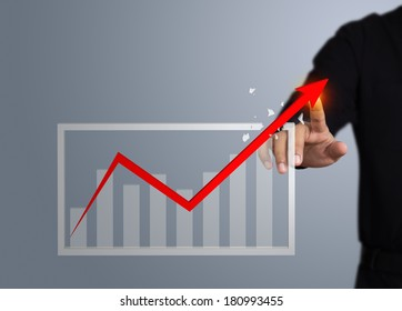 Businessman touching a rising arrow, Business growth concept