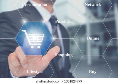 Businessman touching shopping cart icon internet shopping