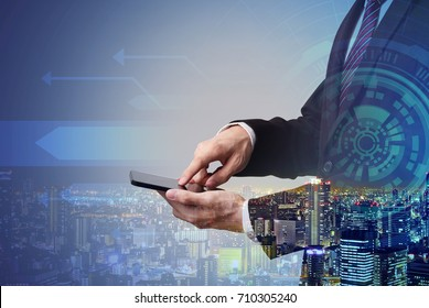 businessman touching smartphone with digital technology layer effect