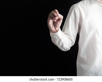 Businessman touching something .Idea business on black background.